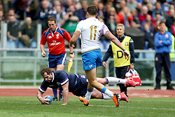 Scotland's Fraser Brown scores his side's first try during the NatWest 6 Nations match at the Stadio Olimpico, Rome.