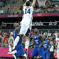 29 July 2012: USA Anthony Davis goes for the dunk during the 98-71 Team USA victory over Team France, during the men's basketball preliminary, at the Basketball Arena, in London, Great Britain.