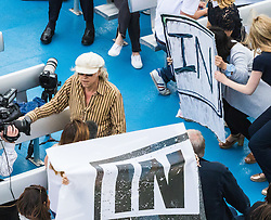 London Bridge, London, June 15th 2016. A flotilla of fishing boats led by UKIP's Nigel Farage heads through Tower Bridge in protest against the EU's Common Fisheries Policy and in support of Britain leaving the EU. PICTURED: Sir Bob Geldof (wearing a cap) aboard his boat counter protesting the Farage flotilla