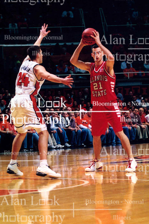 December 18, 2001: University of Illinois Fighting Illini basketball player Sean Harrington and Illinois State Redbirds basketball player Shawn Jeppson...This image was scanned from a print.  Image quality may vary.  Dust and other unwanted artifacts may exist.