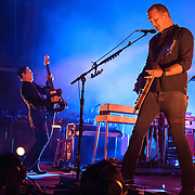 "COLUMBIA, MD - July 17th, 2014 - Troy Van Leeuwen and Josh Homme of Queens of the Stone Age perform at Merriweather Post Pavilion. The band's 2013 album, ""…Like Clockwork,"" was the group's first album to top the US Billboard 200 album charts. (Photo by Kyle Gustafson / For The Washington Post)"
