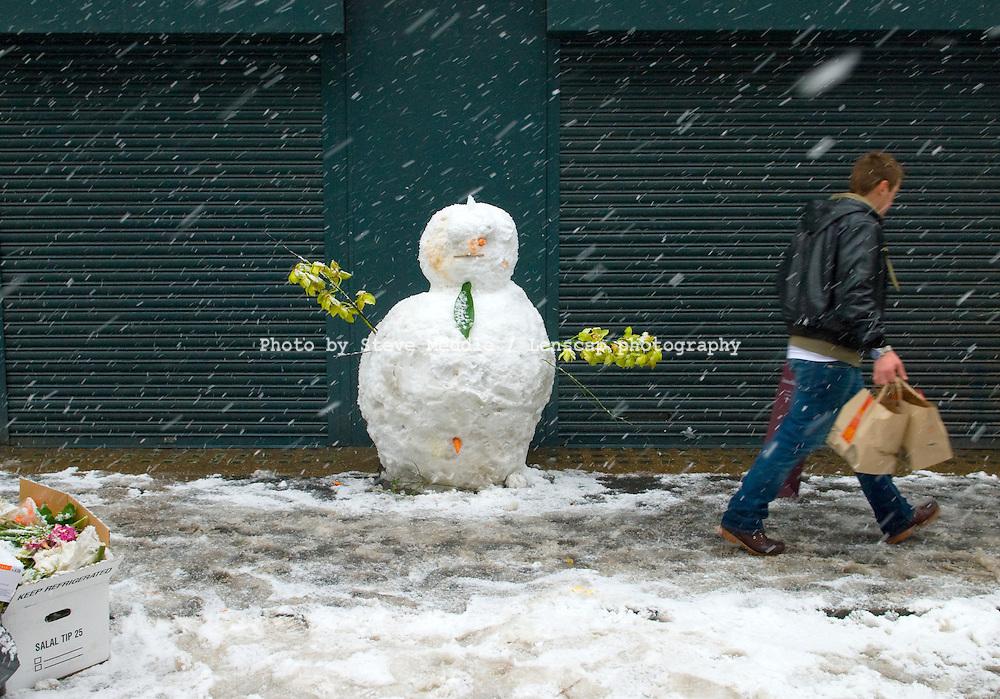 Snowman in Leather Lane Market, London, Britain.