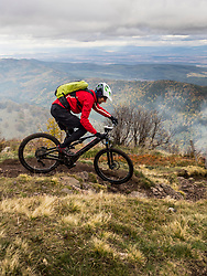 Man riding electric mountain bike on single trail, Vosges, France