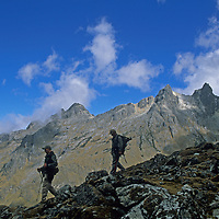 Members of a National Geographic archaeology expedition cross Choquetecarpo Pass (5100+ meters) in Peru's Cordillera Vilcabamba mountains, en route to a site on Cerro Victoria at the end of the canyon below them.