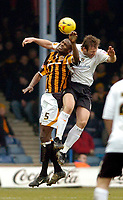 Photo: Leigh Quinnell.<br /> Luton Town v Hull City. Coca Cola Championship. 04/02/2006. Hulls Leon Cort rises with Lutons Steve Howard.