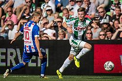 (L-R) Martin Odegaard of sc Heerenveen, Django Warmerdam of FC Groningen during the Dutch Eredivisie match between FC Groningen and sc Heerenveen at Noordlease stadium on August 13, 2017 in Groningen, The Netherlands
