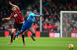 Steve Cook of Bournemouth fouls Danny Welbeck of Arsenal - Mandatory by-line: Alex James/JMP - 14/01/2018 - FOOTBALL - Vitality Stadium - Bournemouth, England - Bournemouth v Arsenal - Premier League