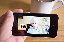 watching Queen's Diamond Jubilee speech on streaming video news website on an iPhone smartphone