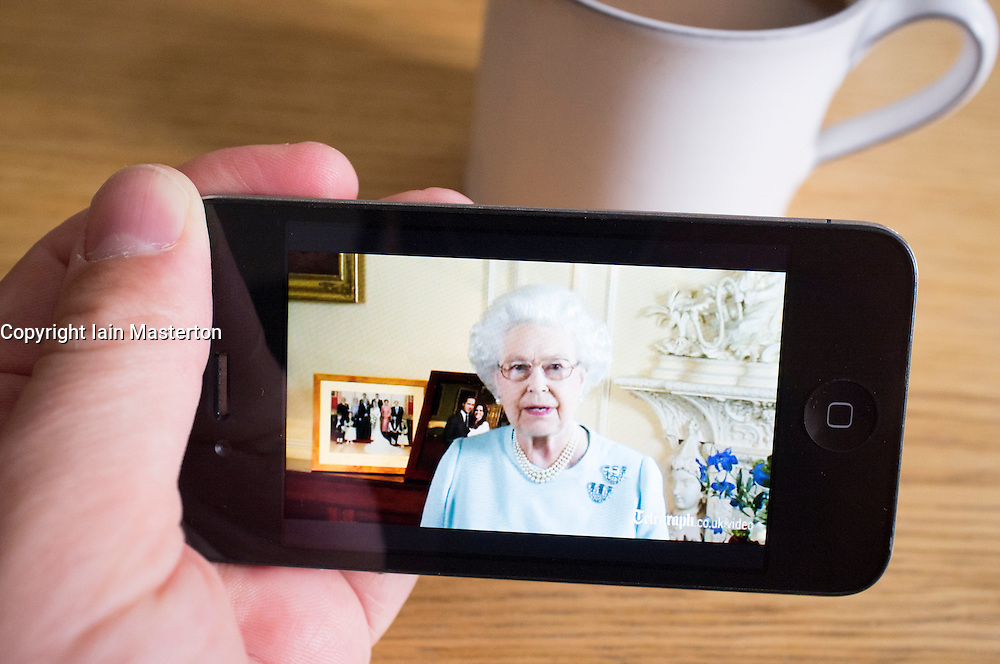 watching Queen's Diamond Jubilee speech on streaming video news website on an iPhone smartphone