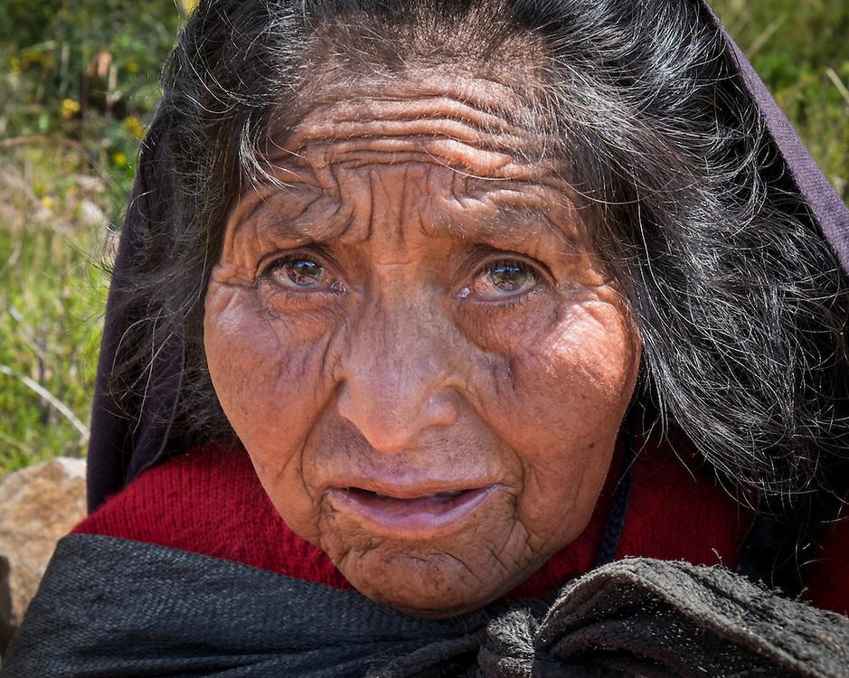 TAQUILE ISLAND, PERU - CIRCA APRIL 2014: Portrait of old woman from Taquile Island in Peru