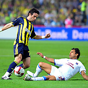 Fenerbahce's Gokhan GONUL (L) and Trabzonspor's Alan Carlos Gomes Da COSTA (R) during their Turkish superleague soccer derby match Fenerbahce between Trabzonspor at the Sukru Saracaoglu stadium in Istanbul Turkey on Sunday 16 May 2010. Photo by TURKPIX