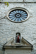 Portal with rose window and statue, Krka Franciscan Monastery, island of Visovac, Krka National Park, Croatia