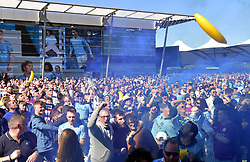 Manchester City fans celebrate at the Etihad Stadium, Manchester.