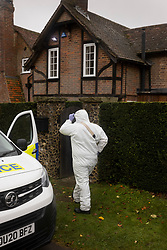 © Licensed to London News Pictures. 24/10/2020. Christmas Common, UK. A police forensics investigator enters a house at Christmas Common near Watlington Hill after the body of a woman was found on Friday 23rd October. An injured man was arrested by police nearby after a man was seen acting suspiciously in a pub. Photo credit: Peter Macdiarmid/LNP