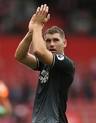 Burnley's Sam Vokes applauds the fans after the final whistle