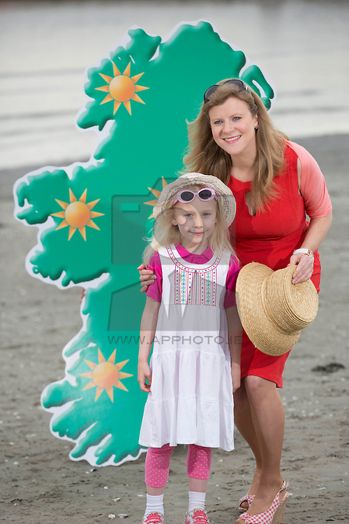 Repro Free: Dublin 28/04/2014 <br /> Met Éireann's Nuala Carey with the help of Alex McDonnell (age 5) from Rathgar was on hand to map out how to be SunSmart this Summer season by following SunSmart Code.<br /> Skin cancer cases in Ireland have now reached over 10,000 annually for the first time, according to the Irish Cancer Society who today launched their annual SunSmart campaign. The Society is urging the public to be SunSmart over the coming months and reduce their risk of skin cancer.<br /> The public can simply follow the four steps of the SunSmart Code for the best protection and check the Society's UV Index daily (available on www.cancer.ie/uvindex ) to find out how high UV levels are in their area. If the UV Index is three or higher it is important to protect the skin when outdoors by following the SunSmart Code.  Picture Andres Poveda