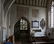 Medieval wall paintings and wall memorial monuments in side chapel of the church of Saint Mary, Purton, Wiltshire, England, UK