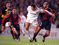 Mark Viduka (Leeds) holds off Abelardo as Xavi (Barcelona) closes in. Leeds United v Barcelona. European Champions League, Group H, 24/10/00. Credit: Colorsport / Andrew Cowie.