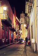 16 JANUARY 2002, GUANAJUATO, GUANAJUATO, MEXICO: Templo San Bautista, framed by the historic architecture of Guanajuato is lit up at night in the city of Gunajuato, state of Guanajuato, Mexico, Jan. 16, 2002.  .PHOTO BY JACK KURTZ