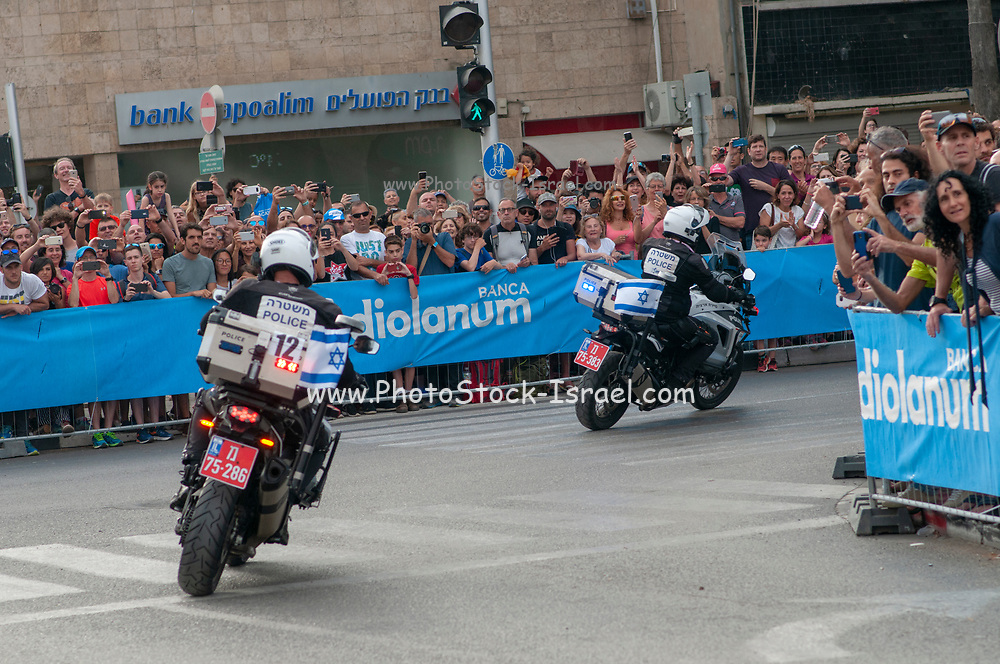Israeli policemen on motorcycles clearing the path at a sports event