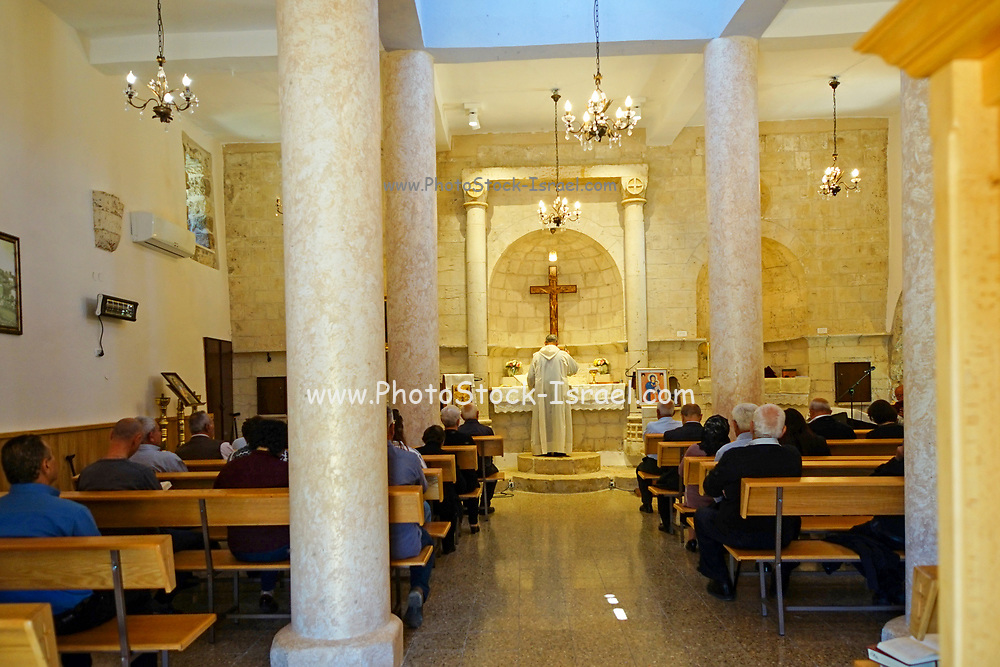 Interior of the Martonite church of Kafr Bir'im during a rare religious service. Kafr Bir'im, also Kefr Berem, was a Palestinian Arab village in Mandatory Palestine, located in modern-day northern Israel, 4 kilometers (2.5 mi) south of the Lebanese border. The Arab inhabitants were expelled in 1948 and till today have not been allowed to return