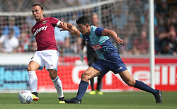 West Ham United's Mark Noble is challenged by Wycombe Wanderers Luke O'Nien during a pre-season match at Adams Park, Wycombe.