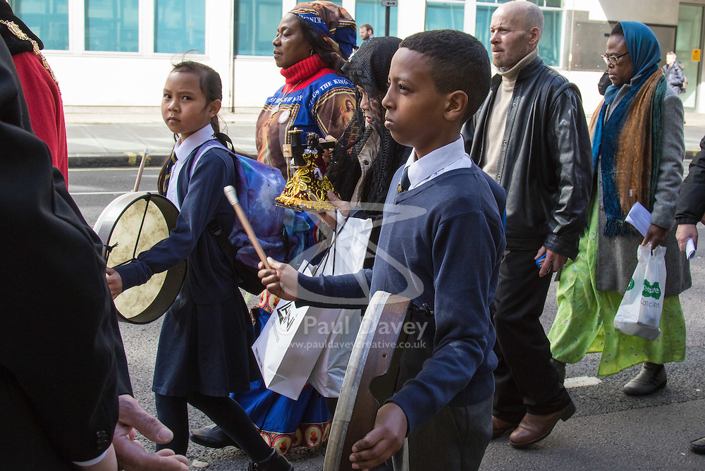"""Westminster, London, March 25th 2016. Westminster's annual interdenominational Easter procession takes place with a procession from Methodist Central Hall to Westminster Cathedral and then on to Westminster Abbey, with the cross borne by people from The Passage, a homeless charity. PICTURED: Their drums beating """"as Jesus' heart"""", two children from St Vincent de Paul Primary School in Victoria. <br /> ©Paul Davey<br /> FOR LICENCING CONTACT: Paul Davey +44 (0) 7966 016 296 paul@pauldaveycreative.co.uk"""