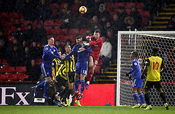 Watford goalkeeper Ben Foster punches clear under pressure from Cardiff City's Callum Paterson during the Premier League match at Vicarage Road, Watford.