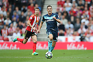 Middlesbrough midfielder Stewart Downing (19)  tries to break free  during the Premier League match between Sunderland and Middlesbrough at the Stadium Of Light, Sunderland, England on 21 August 2016. Photo by Simon Davies.