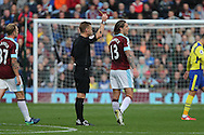 Jeff Hendrick of Burnley receives a yellow card from referee  Mike Jones. Premier League match, Burnley v Everton at Turf Moor in Burnley , Lancs on Saturday 22nd October 2016.<br /> pic by Chris Stading, Andrew Orchard sports photography.