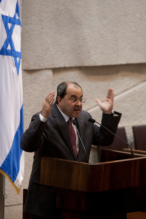 Arab-Israeli Member of the Knesset Ahmad Tibi gestures as he delivers a speech at the Knesset, Israel's parliament in Jerusalem, on December 12, 2011.