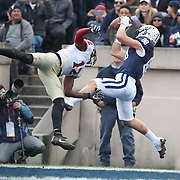 EW HAVEN, CONNECTICUT - NOVEMBER 18: JP Shohfi #88 of Yale scores a touchdown as he receives a pass from quarterback Kurt Rawlings in the end zone while defended by Isaiah Wingfield #12 of Harvard during the Yale V Harvard, Ivy League Football match at the Yale Bowl. Yale won the game 24-3 to win their first outright league title since 1980. The game was the 134th meeting between Harvard and Yale, a historic rivalry that dates back to 1875. New Haven, Connecticut. 18th November 2017. (Photo by Tim Clayton/Corbis via Getty Images)