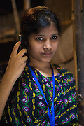 Roxana, a garment worker in Dhaka, Bangladesh, taking part in LaborVoice's SmartLine, which allows workers to share feedback on their safety and working conditions, quickly and anonymously via their mobile phone.<br /> <br /> The SmartLine provides brands and suppliers real-time visibility into factory conditions, enabling them to identify and solve problems before they become urgent.
