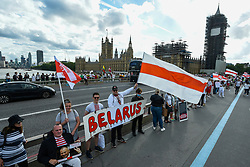 © Licensed to London News Pictures. 23/08/2020. LONDON, UK. People from the Belarus community in the capital form a human freedom chain on Westminster Bridge in solidarity with the people of Belarus who are protesting against the re-election of President Alexander Lukashenko.  Photo credit: Stephen Chung/LNP