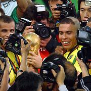 l-r; Brazil's Rivaldo and Ronaldo celebrate with the trophy
