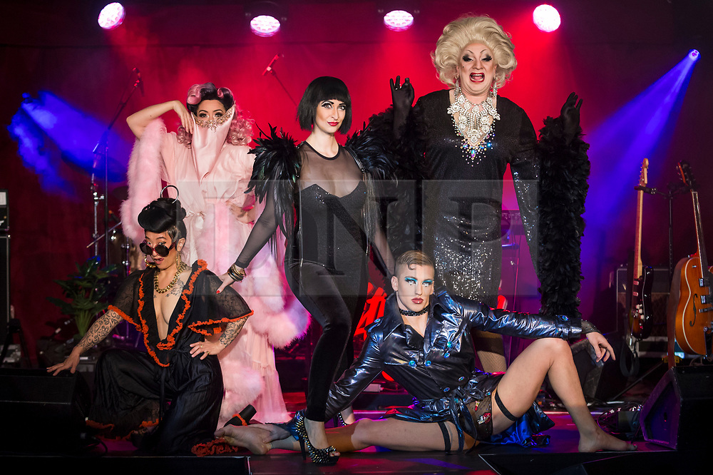 """© Licensed to London News Pictures. 24/04/2019. LONDON, UK. (L to R) Fancy Chance, Kitty Bang Bang, Bernie Dieter, Beau Sargent and Myra Dubois pose at the preview of Bernie Dieter's """"Little Death Club"""" an eclectic performance show taking place at the Underbelly Festival on the Southbank until 23 June 2019.  Photo credit: Stephen Chung/LNP"""