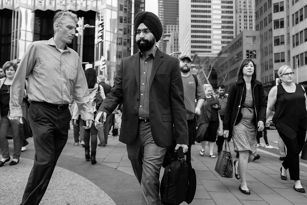 In early 2016 I felt a strong need to photographically explore a 12-block area in Toronto, known as the Financial District. I wanted to better understand the environment where 250,000 people worked and commuted each workday, in its unique Canadian context.
