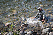 Pat Bogdan releases a large and fiesty Dean River chinook back to the depths.
