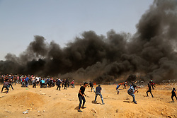 April 13, 2018 - Gaza, Gaza strip, Palestine - Palestinians protest near the border fence with Israel, east of Gaza City in the central Gaza Strip on. Several thousand Gazans gathered for a third consecutive Friday of mass protests along the border with Israel after violence in which Israeli forces have killed 33 Palestinians and wounded hundreds of others. (Credit Image: © Majdi Fathi/NurPhoto via ZUMA Press)