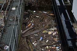 © Licensed to London News Pictures. 03/01/2016. York, UK. Rubbish from the flood waters collects in the Foss Basin close to the Foss Barrier in York. Photo credit : Anna Gowthorpe/LNP