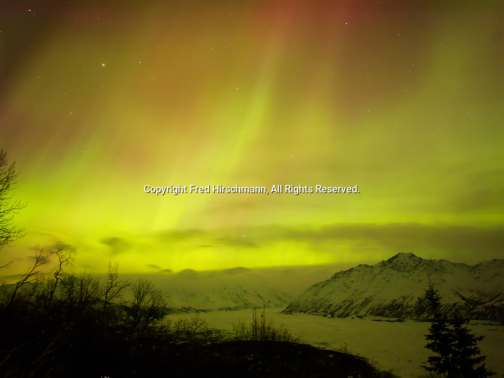 Green and red auroras above the Matanuska Glacier during St. Patrick's Day Geomagnetic Storm, early morning hours of March 17, 2015, Glacier View, Alaska.