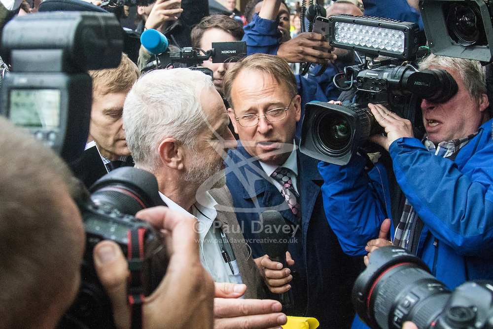 Labour Leader Jeremy Corbyn is swamped in a media scrum as he arrives at Southside in Victoria Street as Labour's National Executive Committee prepares to rule on whether Mr Corbyn should automatically be included in the party's leadership ballot, triggered by ex-shadow business secretary Ms Eagle's leadership challenge.