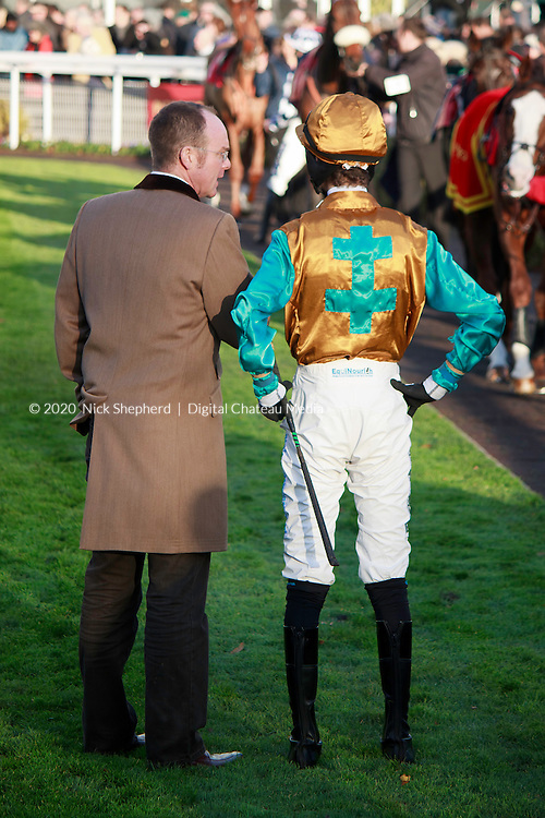 Joshua Moore with trainer G.L.Moore at Sandown Park Racecourse - Editorial Use Only
