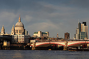 St. Paul's Cathedral and City skyscrapers in the distance, just before sunset