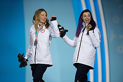 March 12, 2018 - Pyeongchang, South Korea - Gold medalist Brenna Huckaby of the US, right, celebrates with teammate Amy Purdy (silver) during a medal ceremony for Women's Snowboard Cross Monday, March 12, 2018 at the Medals Plaza for the 2018 Pyeongchang Winter Paralympic Games. Photo by Mark Reis (Credit Image: © Mark Reis via ZUMA Wire)