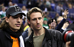 Arsenal's Hector Bellerin and Per Mertesacker in the crowd during the NBA London Game 2018 at the O2 Arena, London.