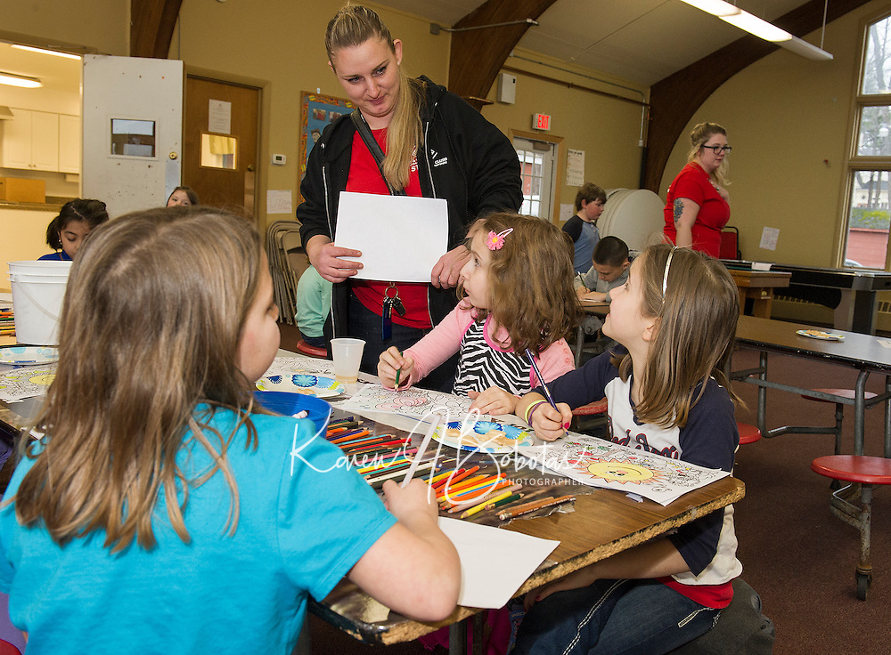 Junior program director Mariah Hoffmann checks in with the 2nd to 4th grade group during after school programs at the Boys and Girls Club on Monday afternoon.  (Karen Bobotas/for the Laconia Daily Sun)