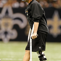 November 28, 2011; New Orleans, LA, USA; New Orleans Saints head coach Sean Payton watches from the sideline on crutches during the fourth quarter of a game against the New York Giants at the Mercedes-Benz Superdome. The Saints defeated the Giants 49-24. Mandatory Credit: Derick E. Hingle-US PRESSWIRE