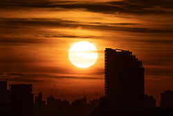 © Licensed to London News Pictures. 18/04/2021. London, UK. The sun sets over the London Skyline. Temperatures are expected to rise with highs of 17 degrees forecasted for parts of London and South East England later this week . Photo credit: George Cracknell Wright/LNP