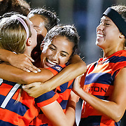 UC Irvin Teammates surround UC Irvine player Shelby Lee (21) after kicking winning penalty point against Cal State Fullerton.<br /> <br /> Photo by Ozzy Jaime, Sports Shooter Academy